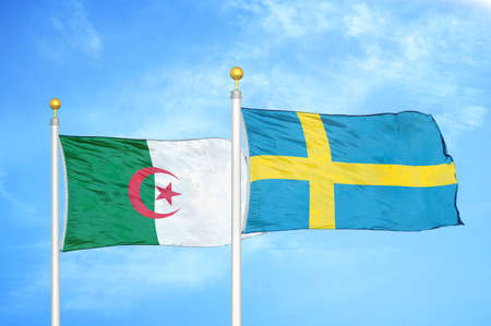 Algeria and Sweden two flags on flagpoles and blue cloudy sky background