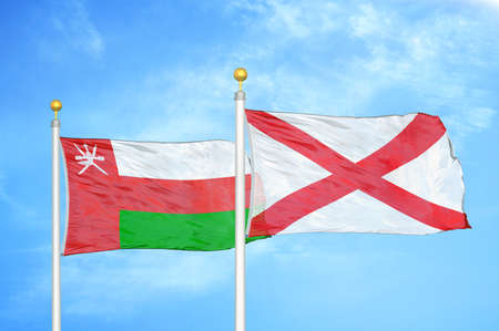 Oman and Northern Ireland two flags on flagpoles and blue cloudy sky background