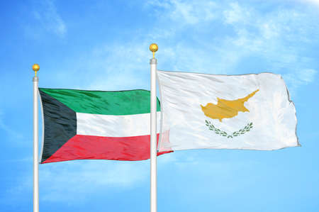 Kuwait and Cyprus two flags on flagpoles and blue cloudy sky background Imagens
