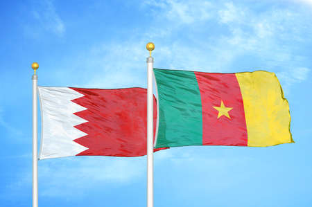 Bahrain and Cameroon two flags on flagpoles and blue cloudy sky background