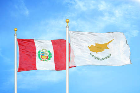 Peru and Cyprus two flags on flagpoles and blue cloudy sky background Imagens