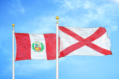 Peru and Northern Ireland two flags on flagpoles and blue cloudy sky background