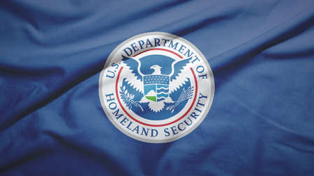 United States Department of Homeland Security flag on the fabric texture background