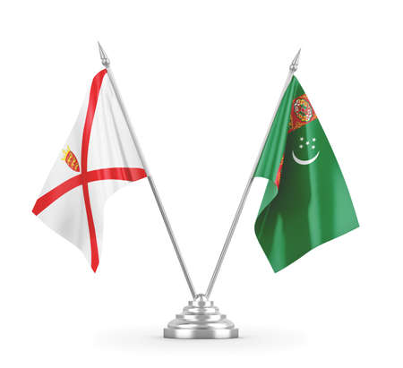Turkmenistan and Jersey table flags isolated on white 3D rendering