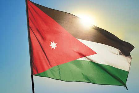 Jordan flag waving on the wind in front of sun Stok Fotoğraf