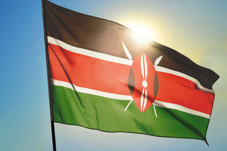 Kenya flag waving on the wind in front of sun