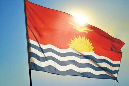 Kiribati flag waving on the wind in front of sun