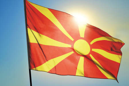 Macedonia flag waving on the wind in front of sun