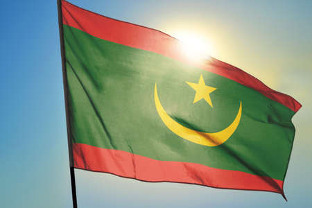Mauritania flag waving on the wind in front of sun