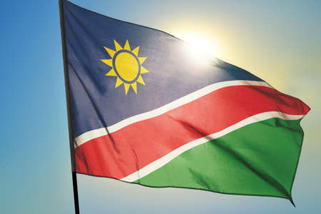 Namibia flag waving on the wind in front of sun