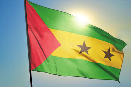 Sao Tome and Principe flag waving on the wind in front of sun