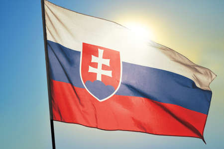 Slovakia flag waving on the wind in front of sun
