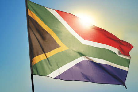 South Africa flag waving on the wind in front of sun 免版税图像