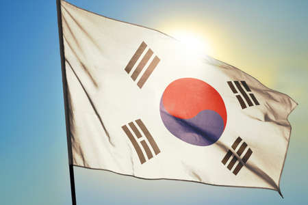 South Korea flag waving on the wind in front of sun