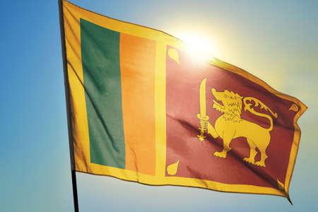 Sri Lanka flag waving on the wind in front of sun Stok Fotoğraf
