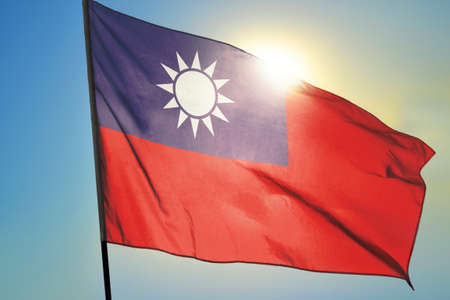 Taiwan flag waving on the wind in front of sun