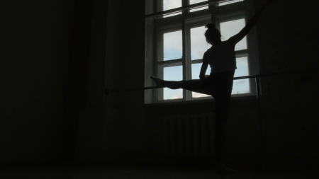 rehearse: Silhouette of a Ballet Dancer Exercising at The Barre By The Window, 4K, UHD
