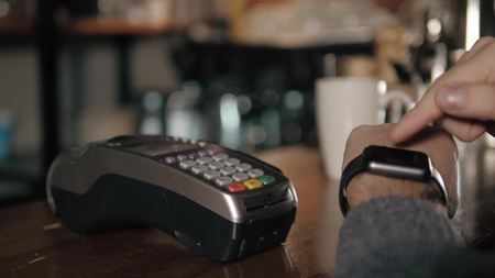 technology transaction: Customer paying with NFC technology