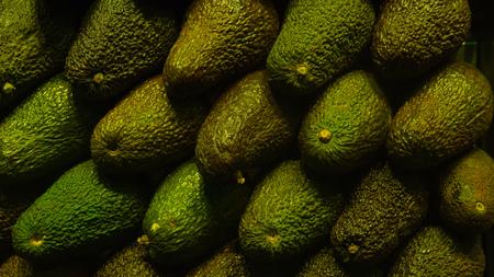 Avocado at a farmers market row background
