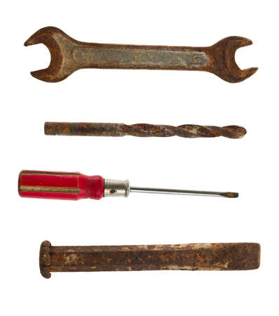 Collection of old tools of the wrench, screwdriver, chisel and drill on a white background photo