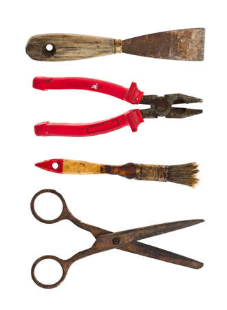 Collection of old tools of  pliers, brush, scissors and a spatula on a white background photo