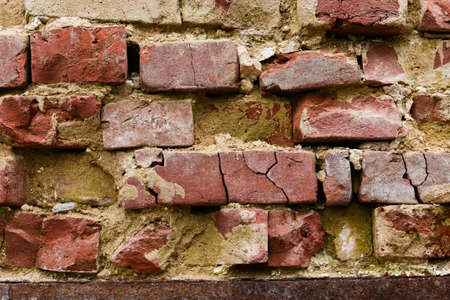 crumbling: Close-up of the old crumbling brick wall for a background Stock Photo