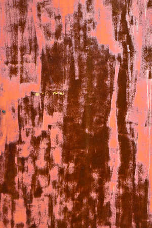 The texture of the old rusty iron, painted pink photo