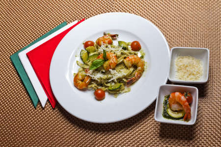 Close up of paste with shrimps and vegetables