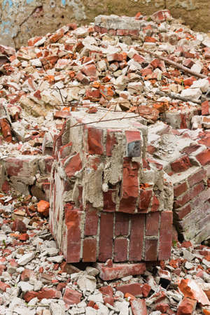 Close-up of a pile of old broken red bricks