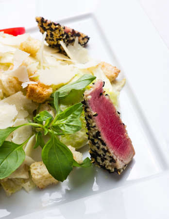 Salad with a tuna in sesame, crackers and vegetables Stock Photo