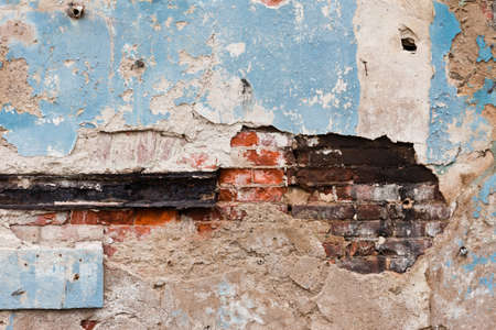Close-up of the old crumbling plastered brick wall Stock Photo