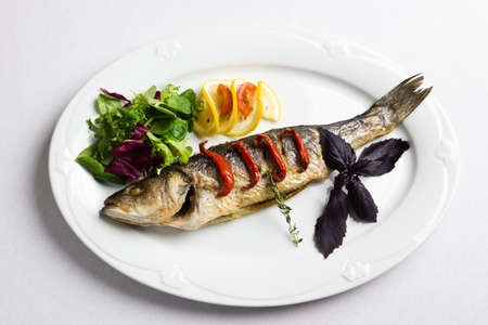 Dish with the baked fish and vegetables