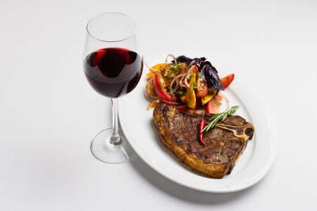 Fried meat with vegetables and red wine