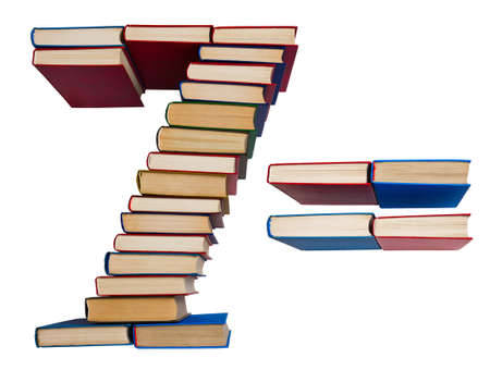 Alphabet made out of old books, figures 7 and equals Stock Photo