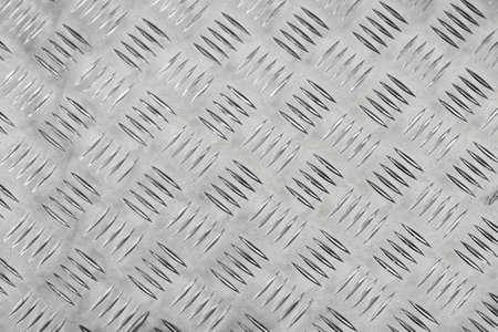 Closeup of metal plate with knurled pattern