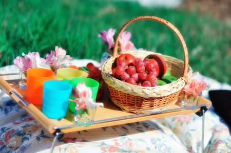 basket with fruit and flowers photo
