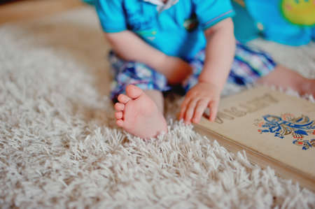 overindulgence: dosy foot of the child on a carpet