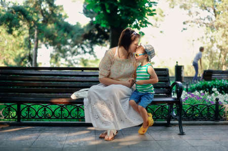 proximity: in park on a bench sit and talk mother to the son