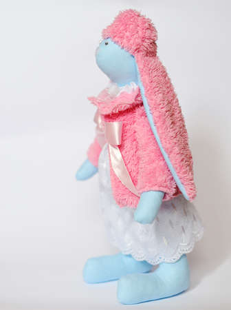 doll a tilde hare in a pink fur coat and a cap photo