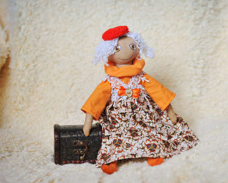 doll with white hair to a red cap with a chest photo