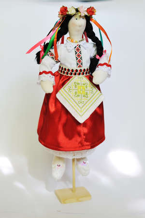 handwork - a doll in a national suit with a wreath on the head photo