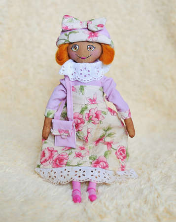 handwork - a doll in a pink dress and a hat with a bag photo