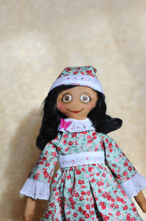doll the Tilde with black hair and in a hat photo