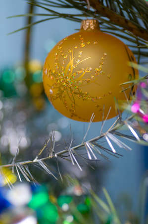 on a green New Year tree color toys hang Stock Photo - 14899110