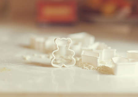 on a white table in the form of flour for cookies is in the form of a bear photo