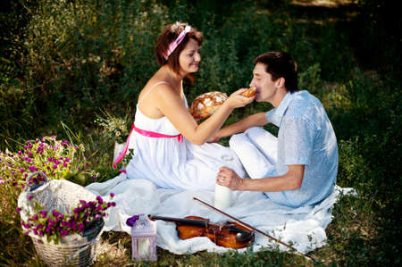 a picnic in the forest girl with a guy who plays the violin photo