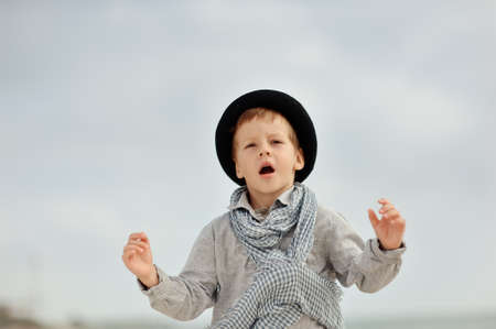 emotional boy in black hat and jeans posing on the beach Stock Photo - 15451884