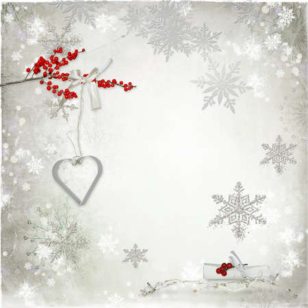 on a light background  different snowflakes and red rowan branch photo