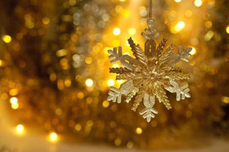 on a gold background shiny big beautiful snowflake