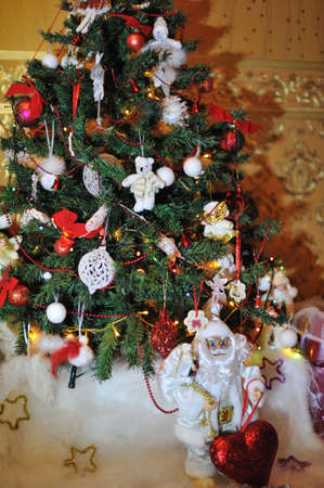 under the Christmas tree is decorated with toys, santa claus in a white suit Stock Photo - 15959560